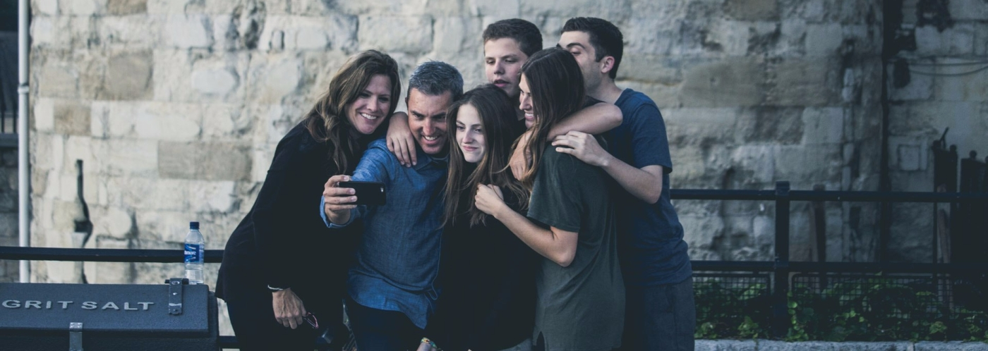 Image of family using phone